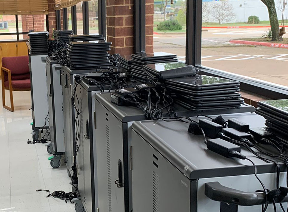 Laptops sit ready to be distributed to students at Guinn Special Programs Center // courtesy Plano ISD