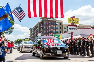 Residents honored former U.S. Congressman Sam Johnson June 8 during his funeral procession in Downtown Plano, which followed a similar route of his homecoming parade in 1973 after being released as a POW // photo Jennifer Shertzer