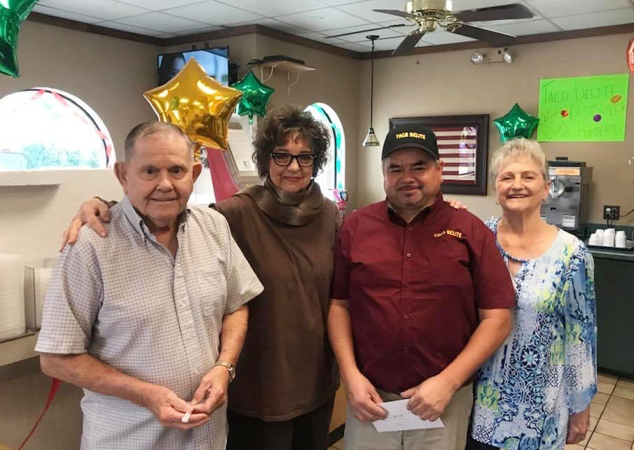 Jerry and Wanda with store manager Humberto and longtime customer Janis Allman // courtesy Rose family